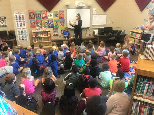 Valley Springs elementary school principal Tanya Palmer reads to students on Wednesday, June 18 as part of the Lynx Summer Reading Program.