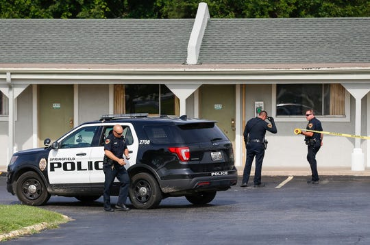 Police investigate the scene at the Dogwood Park Inn in Springfield, Mo., on Friday, June 21, 2019 where they believe a shooting occurred at some point overnight.