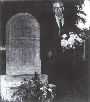 A 1950 News Leader photograph of E.C. Hardy visiting the Thornrose Cemetery grave of Sgt. William D. Funkhouser—a Confederate soldier from Staunton who had worked for Hardy's father.