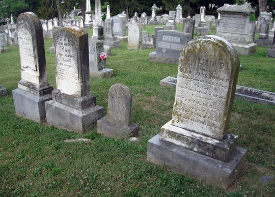 The tombstone of William D. Funkhouser, far right, stands in the Hardy family plot at Thornrose Cemetery.