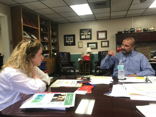 Alina Fooks, a visiting journalist from Moscow in the International Center for Journalists program, interviews Leon County Schools Superintendent Rocky Hanna.