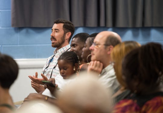 Stuart City Commissioner Mike Meier asks a question regarding police body cameras during a public forum hosted by the NAACP at the East 10th Street Community Services Division on Thursday, June 20, 2019, regarding policing and crime in the community. The event, attended by Stuart Police Chief Joseph Tumminelli and Martin County Sheriff's Office Major Robert Seaman, was held after residents expressed concerns about safety following a homocide in May.