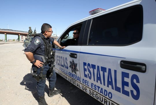 Chihuahua state police forces on patrol along the border in Juarez, Mexico. File art.