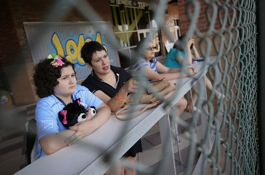 Eleven-year-old Amber Berry watches the El Paso Locomotive FC team practice with her mother, Renee Berry, on Friday, June 21, 2019, at Southwest University Park just before signing her one-day contract to play for the team. The team and The Hospitals of Providence chose Amber as Locomotive Player for the Day for her courage in her fight against leukemia.