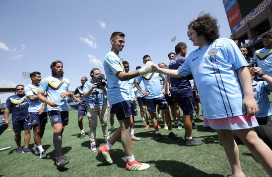 Amber Berry meets her El Paso Locomotive FC teammates at Southwest University Park on Friday, June 21, 2019. She was named the first-ever Locomotive Player for the Day through The Hospitals of Providence.