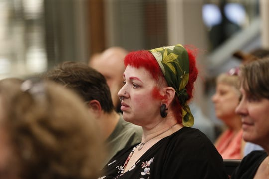 People listen during the Marathon County Board discussion whether to declare June as Pride Month Thursday, June 20, 2019, at the Marathon County Courthouse in Wausau, Wis.