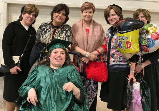 Esther Greenfeld is surrounded by her family on Friday, June 21, 2019 at Jesse J. Kaplan School after graduation ceremonies.