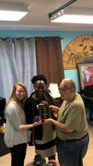 Carissa Mazzeo and Leilani Locket give Edward Branca the Americans for Nonsmokers Rights Smoke Free Advocate of the Year Award.