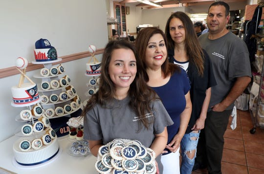 Designer/decorator Marisa O'Connor, left, owners Rose Sanca, Laura Timmons and Jason Elias, with the cupcake display for the Yankees Old-Timers party at Homestyle Desserts Bakery in Peekskill June 21, 2019. The bakery has been making the cakes for the Old Timers Game celebration for the past decade.