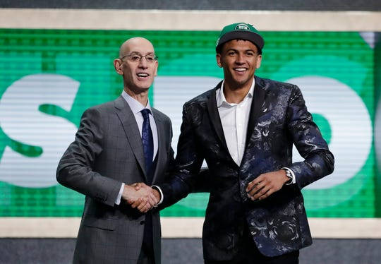 NBA Commissioner Adam Silver poses for photographs with Washington's Matisse Thybulle after the Boston Celtics selected him as the 20th pick overall in the NBA basketball draft Thursday. Thybulle was then traded to the 76ers.