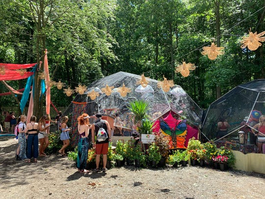 """Outside the Butterfly Dome Experience Friday at Firefly Music Festival in Dover. Based in Louisville, Kentucky, the art installation gives festivalgoers the opportunity to catch butterflies while inside three """"Geodomes."""""""