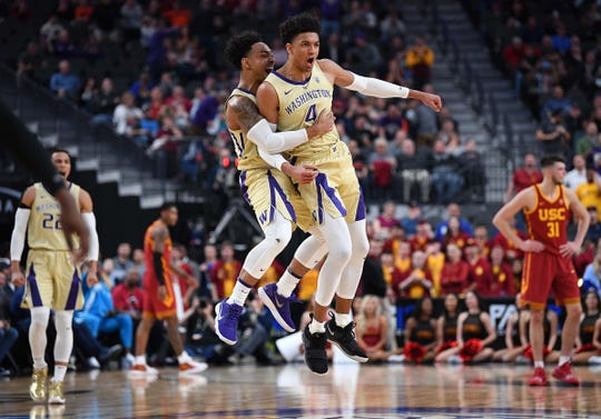 Washington Huskies guard David Crisp (1) celebrates with guard Matisse Thybulle (4) in the final seconds of a Pac-12 conference tournament game against the USC Trojans at T-Mobile Arena, March 14, 2019.