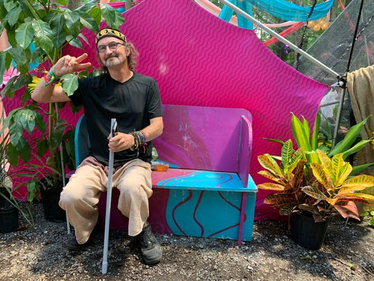 Artist Rob Roberts inside his Butterfly Dome Experience art installation Friday at Firefly Music Festival Dover.