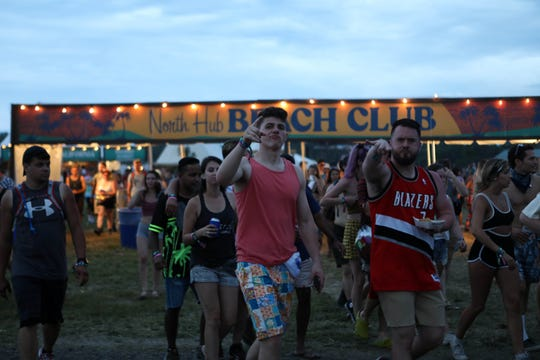 Approaching lightning didn't dampen the mood for some campers as they left the party the North Hub Beach Club to take shelter at Firefly Music Festival in Dover on Thursday, June 20, 2019.