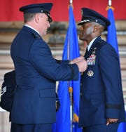 Maj. Gen. Timothy Leahy, commander of the Second Air Force, pins the Legion of Merit medal to outgoing base commander Brig. Gen. Ronald Jolly during the change of command ceremony Friday morning at Sheppard Air Force Base. Jolly served at SAFB from March 2017 to June 21, 2019.