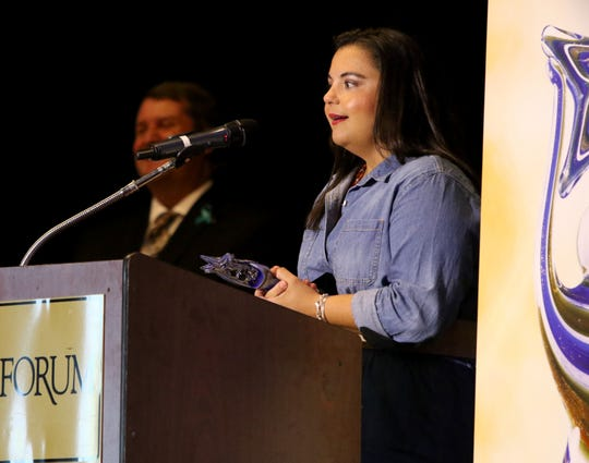 Elizabeth Deerinwater speaks as her father Bud Deerinwater is inducted into the inaugural class of the Nexstar Sports Hall of Fame Thursday, June 20, 2019, in The Forum.