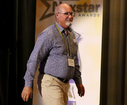 Frank Johnson, Holliday, walks onto the stage after being named the small school Coach of the Year at the first Texoma's Nexstar Sports Awards show Thursday, June 20, 2019, in The Forum.