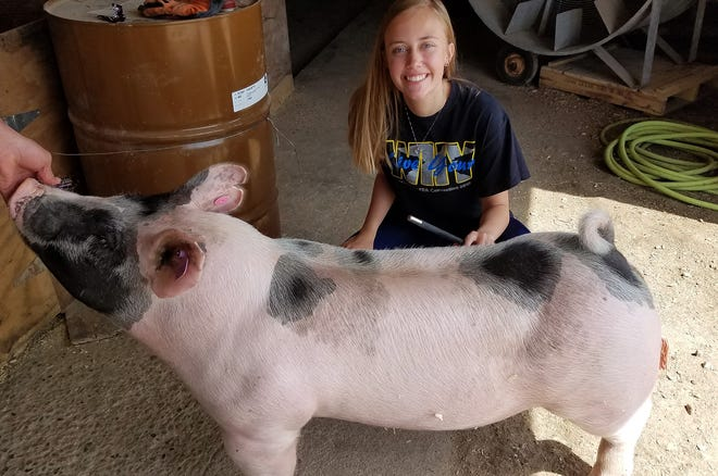 "Emily Butzlaff is sharing her love for pigs with others as she spearheads the effort to host Washington County Fair's first ""Beyond the Banner"" swine show July 28.  The event is intended to provide the opportunity for youth with disabilities to get involved in showing at the fair."