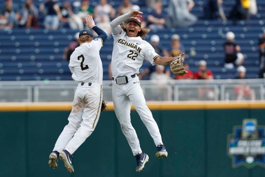 Michigan Wolverines shortstop Jack Blomgren, left, and right fielder Jordan Brewer celebrate after defeating the Texas Tech Red Raiders in the 2019 College World Series at TD Ameritrade Park.
