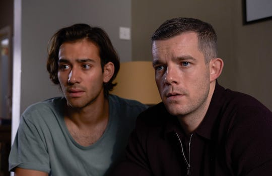 """Housing officer Daniel Lyons (Russell Tovey), right, forms a bond with refugee Viktor (Maxim Baldry) in HBO's """"Years and Years."""""""