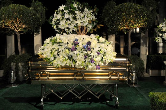 Michael Jackson's gold casket, topped with a huge spray of flowers and a crown, rests at his funeral service at Glendale (Calif.) Forest Lawn Memorial Park on Sept. 3, 2009.