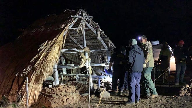 In this photo provided by Pi'ikea Keawekane-Stafford, state and county officials remove Native Hawaiian structures from Mauna Kea, Thursday, June 20, 2019.