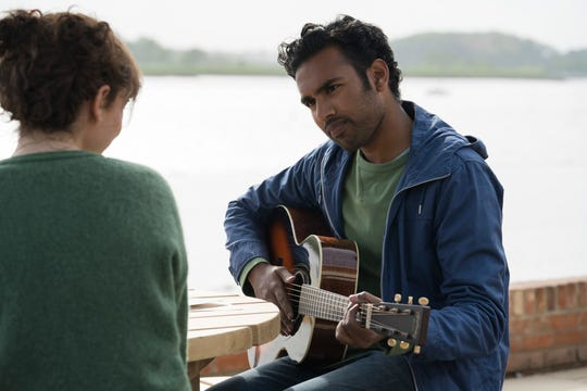 """In a Beatles-less world, Jack (Himesh Patel) impresses his manager, childhood best friend Ellie (Lily James), with a rendition of """"Yesterday."""""""