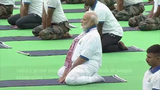 Indian P.M. Narendra Modi practiced various yoga poses alongside an estimated 40,000 people for International Yoga Day in India's eastern state of Jharkhand.