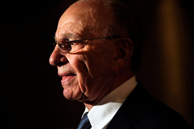 Rupert Murdoch, Chairman of News Corporation speaks to a reporter during a gala launch party on April 26, 2010, in New York.