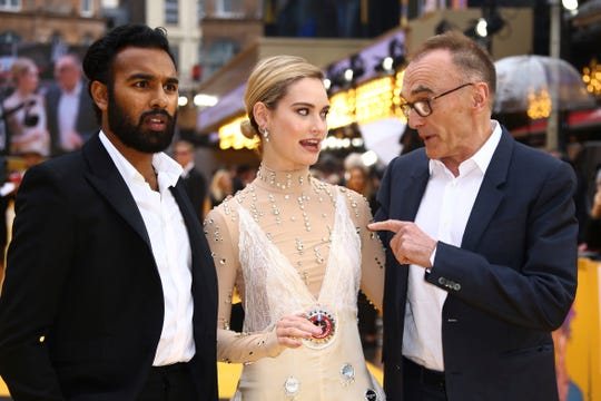 """Himesh Patel (from left) chats with co-star Lily James and director Danny Boyle at the London premiere of """"Yesterday."""""""