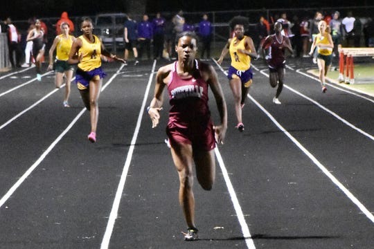 Pinevile sprinter Maygan Shaw (center) fends off competitors at the Tioga Reservation Relays. Shaw is the 2019 All-Cenla Track and Field girls MVP.
