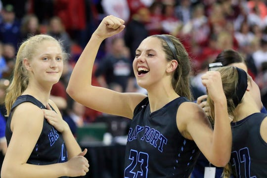 Bay Port's Emma Nagel (23) celebrates after the Pirates won the Division 1 state basketball championship at the Resch Center on March 9.