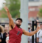 Fond du Lac's Andrew Stone throws in the Division 1 shot put competition at the WIAA state track and field meet at Veterans Memorial Field on June 1.