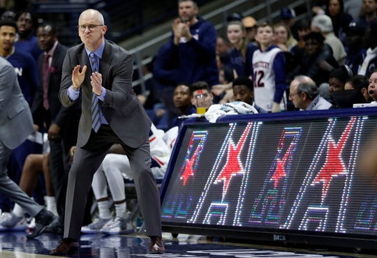 Connecticut Huskies head coach Dan Hurley watches from the sideline as they take on the Temple Owls in the second half at Gampel Pavilion.