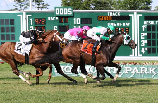 Hunter O'Riley #7 with Paco Lopez aboar gets up to win the Grade I $300,000 United Nations Stalkes Saturday at Monmouth Park. Zula Alpha (No. 6 on the inside) was second and Channel Cat (No. 2), the 8-5 favorite, was third.