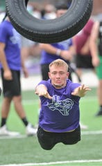 Anson's Kyle St. John throws a tire during the State LineMAN Challenge on Saturday, June 22, 2019, at Hardin-Simmons' Shelton Stadium. Five linemen from each team threw the tire, one after the other, to see how far down the field they could throw it overall. It was one of 11 events in the Challenge.