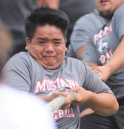 A Sweetwater athlete competes with his teammates in the tug of war competition at the State LineMAN Challenge on Saturday, June 22, 2019, at Hardin-Simmons' Shelton Stadium.