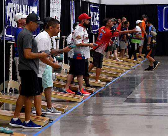 Contestants play Cornhole on Friday at the Abilene Convention Center. The Texas Cornhole League State Championship concluded Saturday.