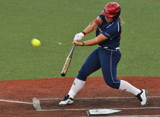 Former Florida Gators star Amanda Lorenz of the Pride sends the ball out of the yard.