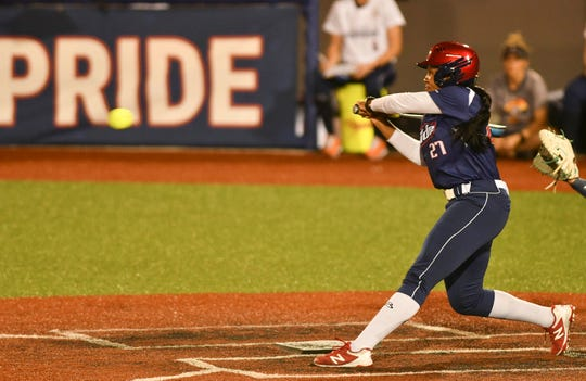 Bianka Bell ends the game with a bases clearing hit during Friday's game against the Aussie Peppers.
