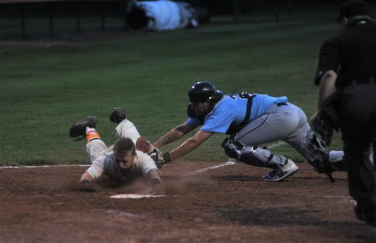 Galion's Andrew Sharp is tagged out sliding into home.