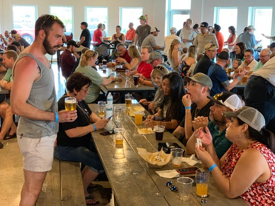 More than a hundred people attended the grand opening of Nueces Brewing Co. in downtown Corpus Christi on Saturday, June 22, 2019.