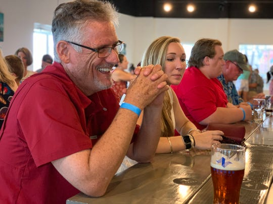 Keith Petras enjoys a pint from Nueces Brewing Co. in downtown Corpus Christi on Saturday, June 22, 2019.