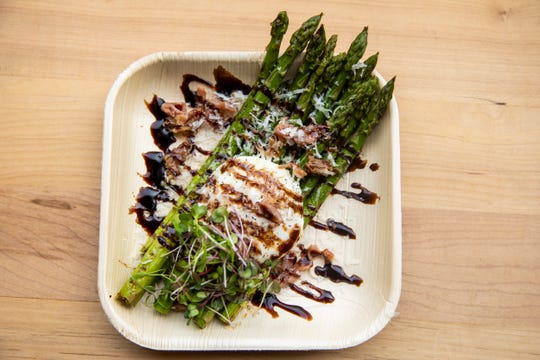 Ripple Wine Bar serves asparagus with an over-easy egg, brown butter, balsamico and pecorino.