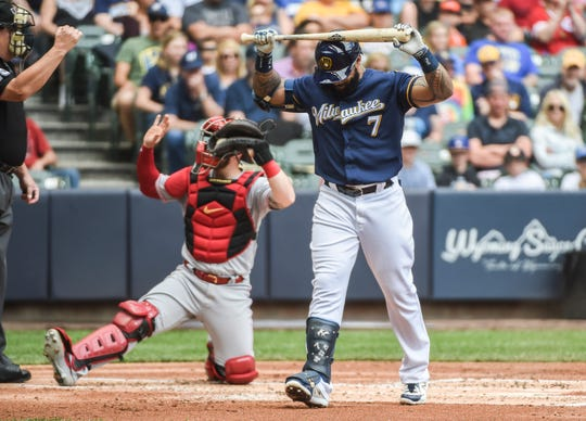 Jun 22, 2019; Milwaukee, WI, USA;  Milwaukee Brewers first baseman Eric Thames (7) reacts after striking out in the first inning against the Cincinnati Reds at Miller Park.