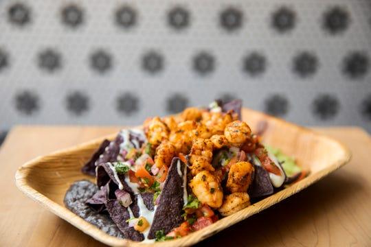 Ripple Wine Bar serves shrimp nachos with avocados, black beans, pico de gallo, pickled serrano and queso frescoa.
