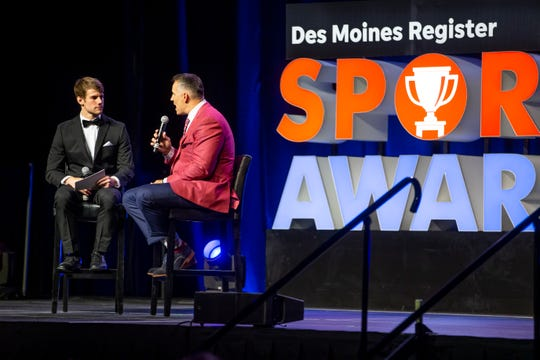 Sports reporter Cody Goodwin interviews NFL star Kurt Warner during the 2019 Des Moines Register All-Iowa Sports Awards on Friday, June 21, 2019, in Des Moines.