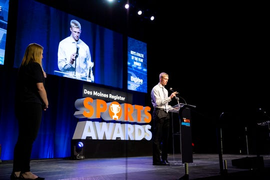 Cedar Falls' Logan Wolf accepts his award for Boys Athlete of the Year during the 2019 Des Moines Register All-Iowa Sports Awards on Friday, June 21, 2019, in Des Moines.