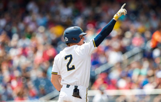 Michigan's Jack Blomgren celebrates after reaching third base against Texas Tech during an NCAA College World Series baseball game Friday, June 21, 2019, in Omaha, Neb.