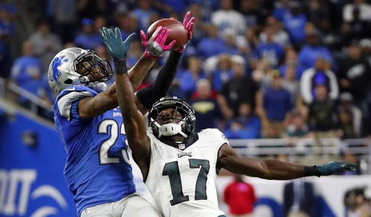Detroit Lions cornerback Darius Slay intercepts a pass intended for Philadelphia Eagles receiver Nelson Agholor, Oct. 9, 2016, in Detroit.